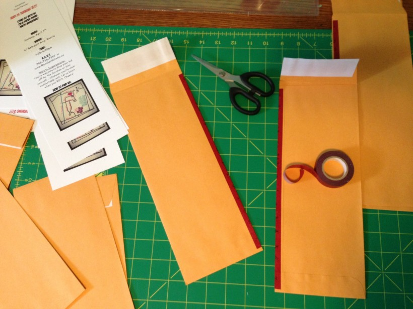 """Because I made the invites longitude-wise, when it came to enveloping time, I was momentarily stumped. But then I realized I could just cut 12""""x9"""" envelopes from top to bottom, tape them with decorative washi tape. Boom, custom envelopes!"""