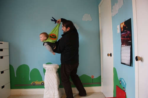 BEFORE: The littlest super! Wee Gene was not into lying on the stool, so Daddy held him up and the cape out.