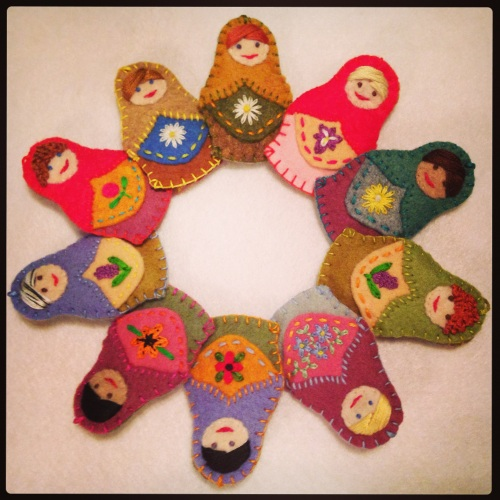 The Littlest Felt Matryoshka. You can order custom, choosing eye and hair colour, and belly flower or emblem. An amazing gift idea! Can be a hanging decoration or a brooch.